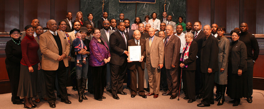 Bro. Dosh Jackson, flanked by family, friends and Omega brothers, is recognized in the Atlanta City Council chambers by Council President Bro. Ceasar Mitchell