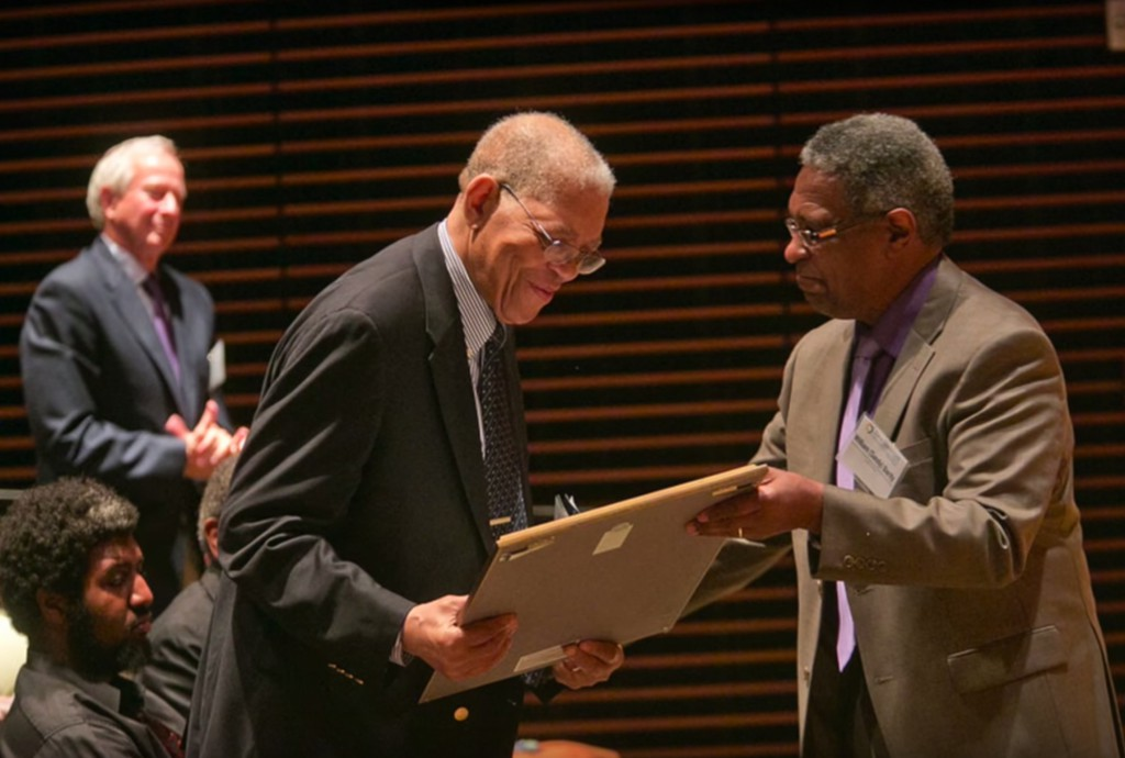 Bro. Samuel DuBois Cook (middle) receives a proclamation from Duke Professor William Darity (right), Director of the Samuel Dubois Cook Center on Social Equity, as Duke President Richard H. Brodhead (top left) looks on