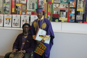 Baba Yoga Bey (left) plays his African drum as Bro. Webster Wallace looks on.