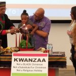 Lighting the Kwanzaa Candle