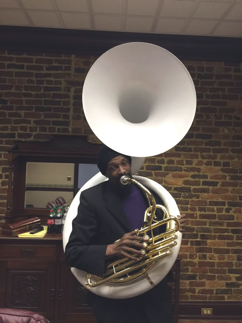 "Bro. Stanley Cooks, director of the ""Ice Cool Band"", with the new sousaphone"